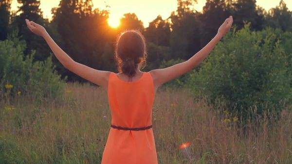 Girl raising her hands to the sun in the morning, faith, hope, slow motion Royalty-free stock video