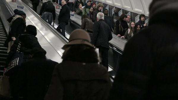 LONDON - February, 21: commuters in Londond escalate in underground station Royalty-free stock video