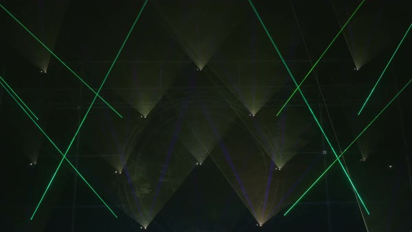 Laser lights and lamps beaming lines and triangular shapes.  Royalty-free stock video