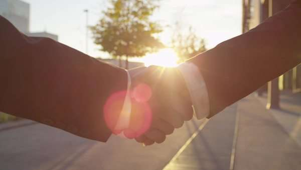 Close-up of business handshake on sunny morning Royalty-free stock video