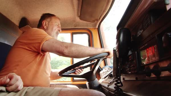 Medium shot of a man driving a truck Rights-managed stock video