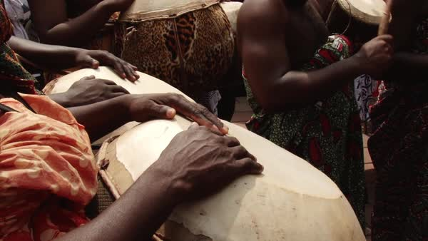 Close-up shot of people playing the drums in Africa Rights-managed stock video