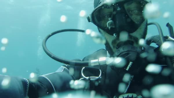 Close up shot of a scuba diver looking into the camera Rights-managed stock video