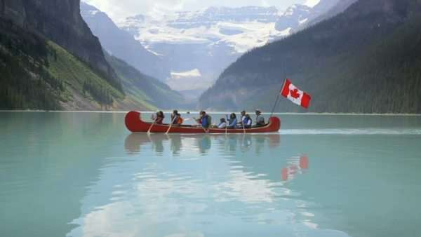 Group canoeing on Lake Louise, Banff National Park, Canada Royalty-free stock video