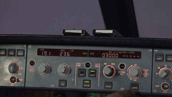 Close-up shot of a pilot pushing a button on the flight instrument Royalty-free stock video