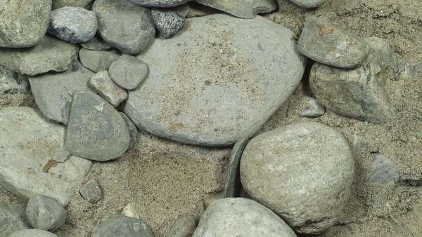 Stop motion of stones in the sand Royalty-free stock video