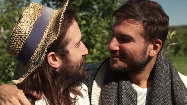 Close-up shot of a gay couple in orchard Royalty-free stock video