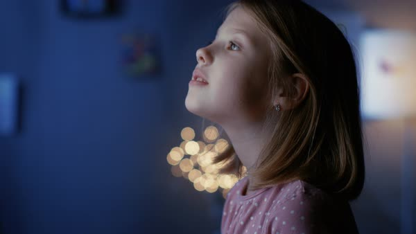 Girl filled with wonder serenely looks out of the window. Royalty-free stock video