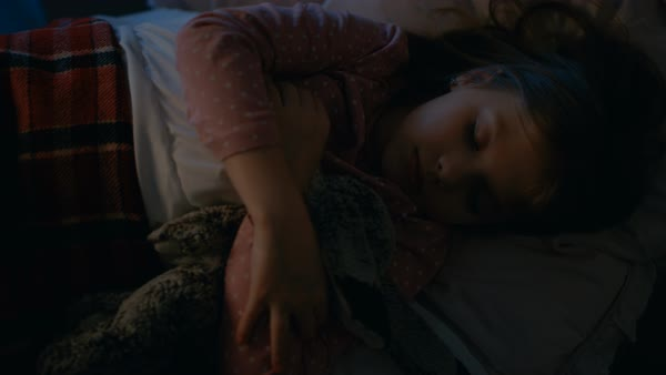 Sweet little girl sleeps in her bed while hugging her plush toys. Royalty-free stock video