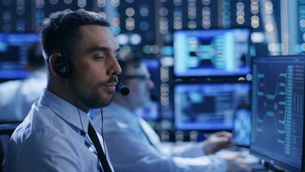 In the system control center technical support team gives instructions with the help of the headsets Royalty-free stock video