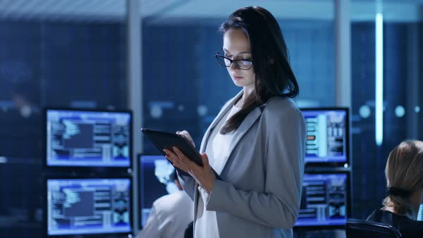 Young female government employee uses tablet in system control center Royalty-free stock video