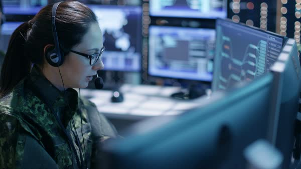 Female military technical support professional gives instructions into headset Royalty-free stock video