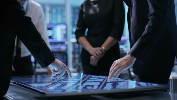 Close-up of surveillance agency's agents hands on interactive touchscreen table, tracking dangerous criminal Royalty-free stock video
