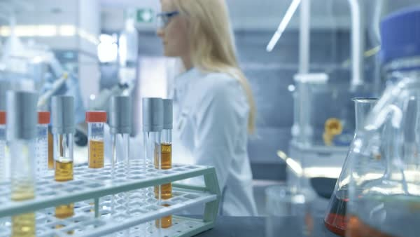Point of view shot from a moving cart with test-tubes, analysis, beakers and various glassware Royalty-free stock video