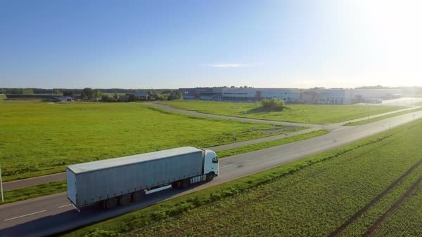 Aerial view of white semi truck with cargo trailer moving on the highway Royalty-free stock video