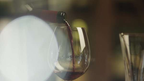 Sommelier filling glass with wine in restaurant. close-up. Royalty-free stock video