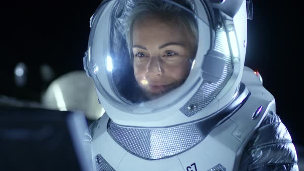 Portrait of female astronaut on the alien planet looking ...
