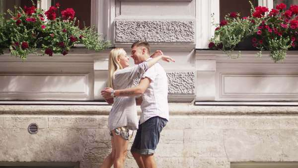 Girlfriend and boyfriend are meeting and hugging in European town. Royalty-free stock video