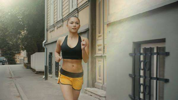 Girl is running at morning time in residential area Royalty-free stock video