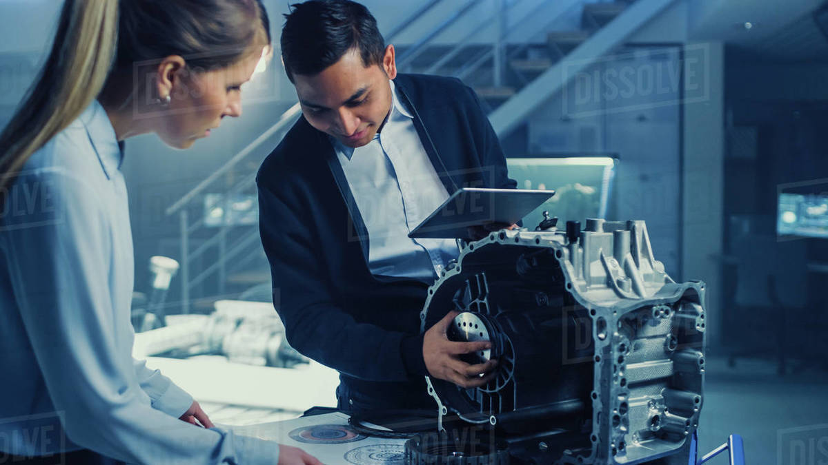 Development Laboratory Room With Professional Automotive Design Engineer Working On A Electric Car Gear Transmission Chassis With Wheels Batteries Engine And Suspension Stock Photo Dissolve