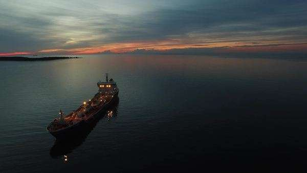 Aerial shot of tanker ship moving in sea at night Royalty-free stock video