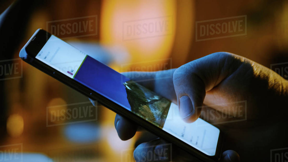 Close-up Macro: Person Holding and Using Smartphone, Browsing through Pictures on Social Network Wall. Finger Scrolling Social Media App Feed: Travel, Animals, Food. Mock-up Application Design Royalty-free stock photo