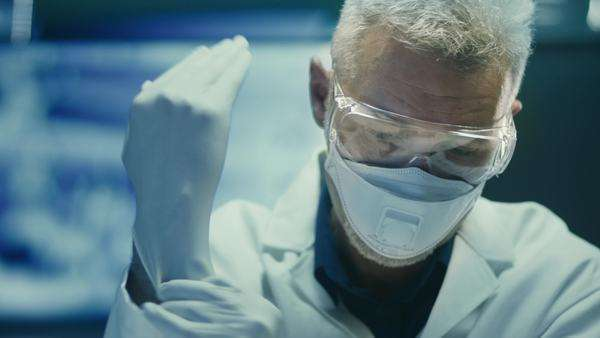 Portrait of scientist in safety glasses and respirator Royalty-free stock video