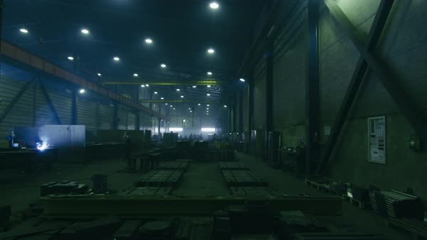Timelapse of a heavy industry factory with workers and flying sparks. Royalty-free stock video