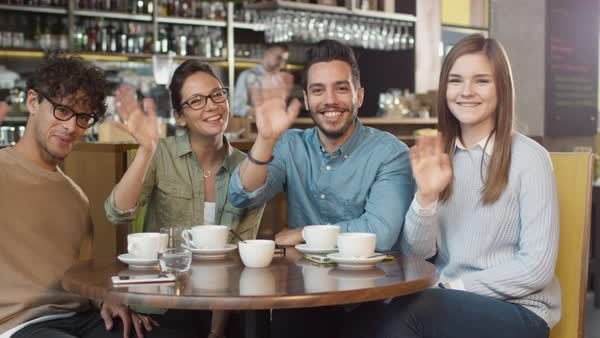 Group of young smiling people looking at camera in coffee shop. Royalty-free stock video