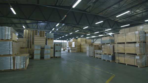 Establishing shot of a warehouse with hardwood Royalty-free stock video