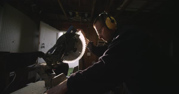 Slow motion shot of a male carpenter cutting wood with a circular saw Royalty-free stock video