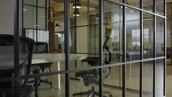 Medium panning shot of glass wall in empty office Royalty-free stock video