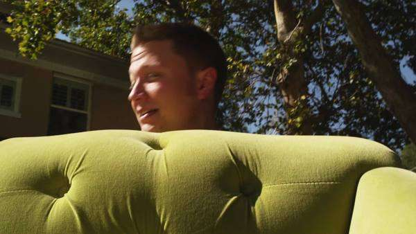 POV close-up of Man carrying sofa into house, Provo, Utah Royalty-free stock video