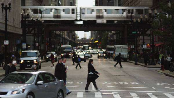 MS Busy street intersection and Chicago Transit Authority elevated train in the Loop, Chicago, Illinois Royalty-free stock video