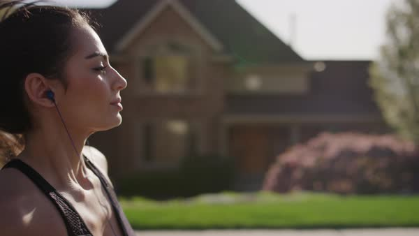 Close up slow motion tracking shot of woman running in neighborhood Royalty-free stock video