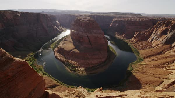 Wide high angle flyover shot of river bend in canyon Royalty-free stock video