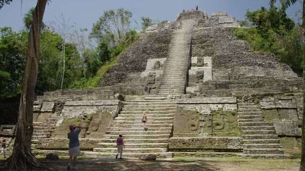 Medium shot of tourists at High Temple, Lamani, Belize, Royalty-free stock video