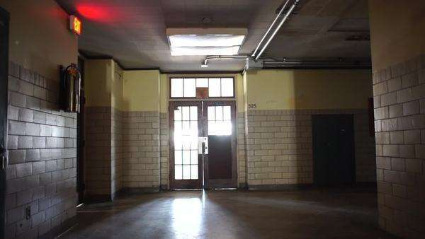 Dimly lit empty school hallway Rights-managed stock video