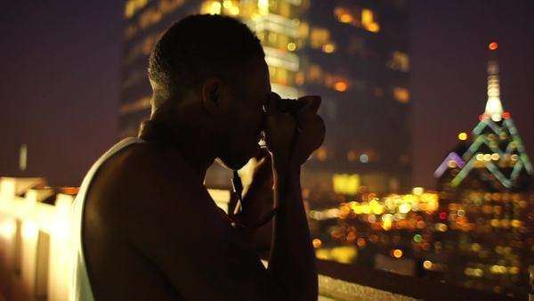 Male photographer taking photos of Philadelphia skyline at night Rights-managed stock video