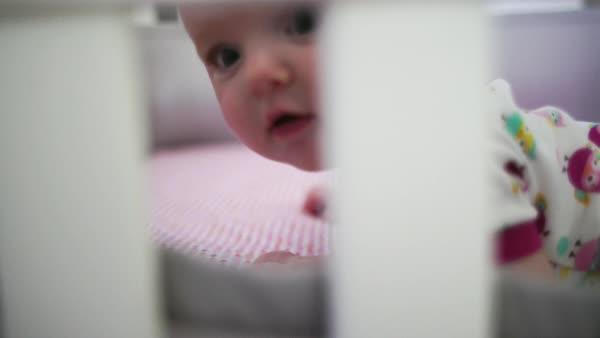 Hand-held close-up of happy baby looking at camera Royalty-free stock video