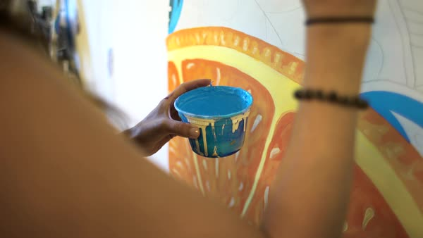 Hand-held shot of a woman holding a bucket of paint Royalty-free stock video