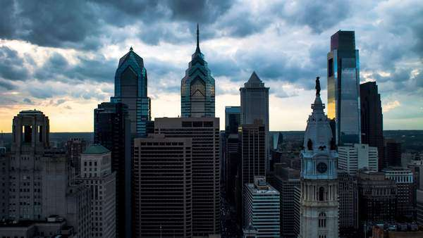 Zooming out shot of dark clouds moving across Philadelphia landmark skyscrapers Rights-managed stock video