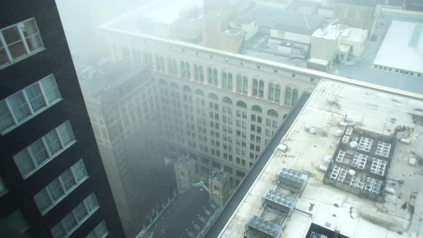 Wide shot of buildings shrouded in fog in Philadelphia Rights-managed stock video