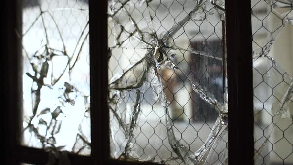 Close up shot of broken glass of a window in Bok School, Philadelphia Rights-managed stock video