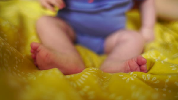Close up shot of a baby girl sitting on a blanket Rights-managed stock video