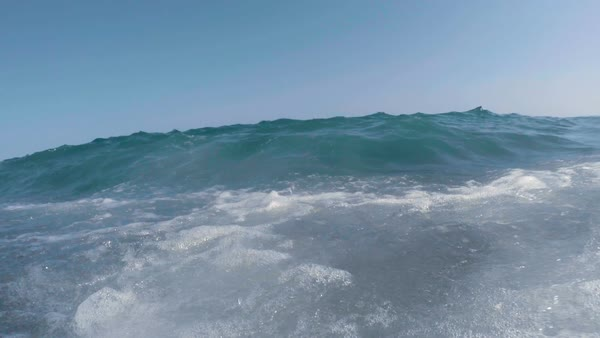 Clear blue sea waves breaking directly on the camera Royalty-free stock video