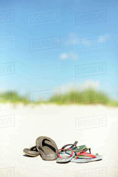 dcb7ea418321 Woman feet in flip-flops and sunhat - Stock Photo - Dissolve
