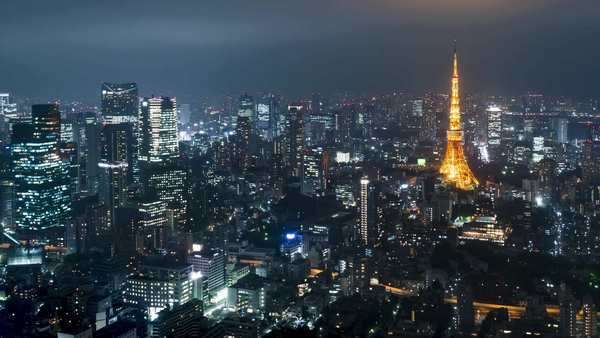 Timelapse of Tokyo from above with Tokyo Tower in the background Royalty-free stock video