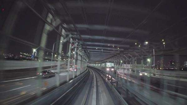 Point of view real-time ride through Tokyo via the automated guideway transit system (AGT) called the Yurikamome. No unwanted window reflections. Royalty-free stock video