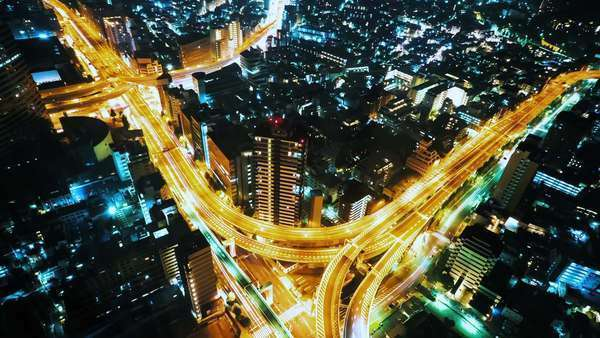 Night becomes day over a massive highway intersection in Shinjuku, Tokyo, Japan Royalty-free stock video